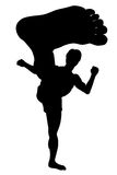 Karate kick. EPS8 editable vector silhouette of a man doing a karate kick with wide-angle perspective Stock Photography