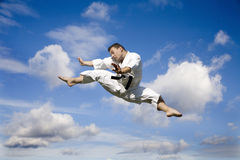 Karate - kicking and the sky Stock Images