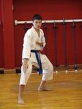 Karate kid. At the dojo training session Royalty Free Stock Image