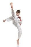 Karate Kid. In your face kick - boy practicing self defense Royalty Free Stock Photography
