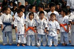 Karate kids. Young Japanese kids (kindergarten age) in kimono practicing karate stock photos