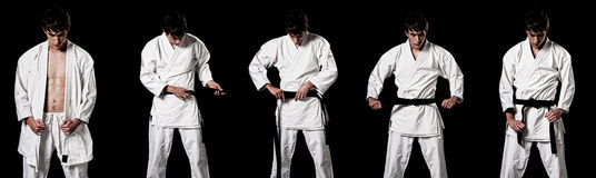 Karate male fighter dressing kimono high contrast. Karate male fighter dressing kimono sequence high contrast composite sequence on black background royalty free stock photo