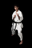Karate male fighter young high contrast on black. Background Stock Photography