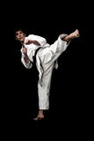 Karate male fighter young high contrast on black. Background Royalty Free Stock Image