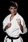 Karate male fighter young high contrast on black. Background Stock Photos