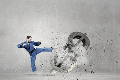 Karate man attack dollar Royalty Free Stock Images