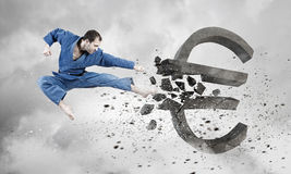 Karate man attack euro Stock Image