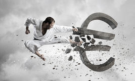 Karate man attack euro Royalty Free Stock Photo