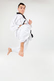 The karate man with black belt Royalty Free Stock Image