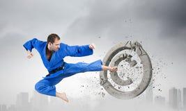 Karate man in blue kimino Royalty Free Stock Photos