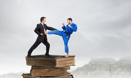 Karate man in blue kimino Royalty Free Stock Photo