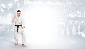 Karate man doing karate tricks on the top of a metropolitan city. Young karate trainer doing karate tricks on the top of a metropolitan cityn stock image