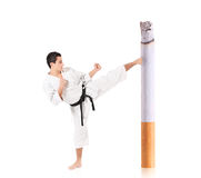 Karate man hitting a cigarette Stock Photos