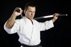 Karate man with katanas Stock Photos