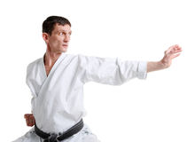 Karate. Man in a kimono. With a white background Royalty Free Stock Photography