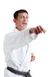 Karate. Man in a kimono. With a white background Stock Photo