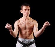 Karate. Man in a kimono Royalty Free Stock Photo