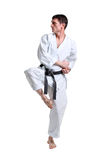 Karate. Man in a kimono. With a white background Royalty Free Stock Image