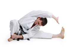 Karate, man in a kimono limberingup. On a white background Stock Photography