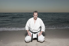 Karate man kneeling Stock Photos
