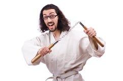 Karate man with nunchucks Stock Photography