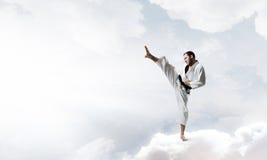 Karate man in white kimino Stock Photography