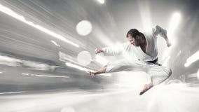 Karate man in white kimino Royalty Free Stock Photo