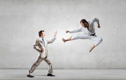 Karate man in white kimino Stock Image