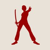 Karate martial art silhouette of woman with sword. Karate martial art silhouette of woman in sword fight karate pose Royalty Free Stock Image