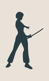 Karate martial art silhouette of woman with sword. Karate martial art silhouette of woman in sword fight karate pose Stock Images