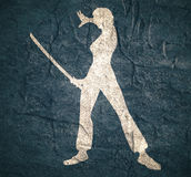 Karate martial art silhouette of woman with sword. Karate martial art silhouette of woman in sword fight karate pose. Concrete textured Royalty Free Stock Image
