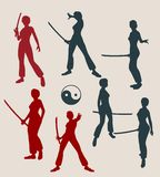 Karate martial art silhouette of woman with sword. Kung Fu martial art silhouettes of woman in sword fight pose. Woman posing Stock Image
