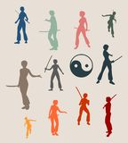 Karate martial art silhouette of woman with sword. Kung Fu martial art silhouettes of woman in sword fight pose. Woman posing Royalty Free Stock Photography