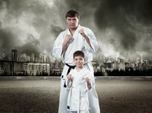 Karate master with his young student Stock Photo