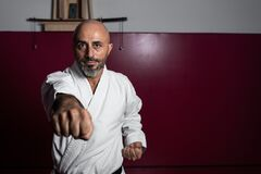 Karate master posing with powerful attitude in his dojo