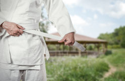 Karate master prepares for combat in high mountain village Royalty Free Stock Photos