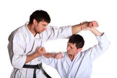Karate. Men in a kimono Stock Images