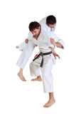 Karate. Men in a kimono with a white background. Royalty Free Stock Images