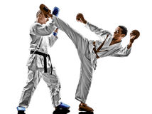 Karate men teenager student fighters fighting protections. Two karate men sensei and teenager student fighters fighting protections isolated on white background Stock Images