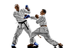 Karate men teenager student fighters fighting protections. Two karate men sensei and teenager student fighters fighting protections isolated on white background Stock Image