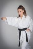 Karate pięści poncza kobieta zdjęcie stock