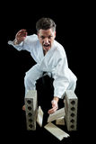 Karate player breaking wooden plank Stock Photos