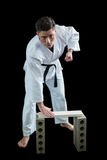 Karate player breaking wooden plank Royalty Free Stock Image