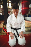 Karate player sitting in seiza position Stock Photography