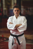 Karate player standing with arms crossed Royalty Free Stock Image