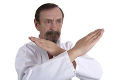 Karate position demontrated by a senior man Stock Photos