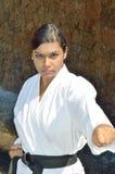 Karate punch. Black belt karate champion punching Royalty Free Stock Photography