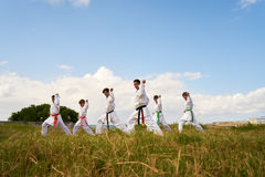 Karate School With Teacher And Boys Warming Up Royalty Free Stock Image