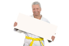 Karate  Senior man   with poster Royalty Free Stock Photo