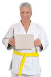 Karate  Senior man   with poster Stock Images